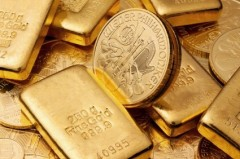 Feingold als Barren und Münzen
